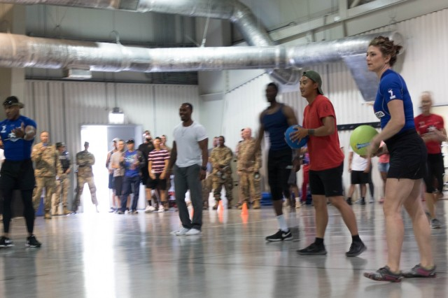 American Gladiators play a game of dodgeball with military personnel July 4th, 2019, during a visit to Mihail Kogalniceanu Air Base, Romania. The Gladiator's visit was part of a tour across Europe to entertain and boost the morale of service members and participants through themed competitions and interactive events. (U.S. Army photo by Pvt. Michael Ybarra)