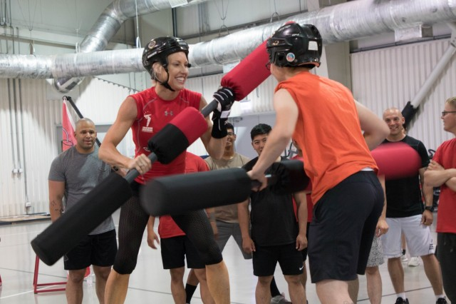 American Gladiators compete in jousting matches with military personnel July 4th, 2019, during a visit to Mihail Kogalniceanu Air Base, Romania. The Gladiator's visit was part of a tour across Europe to entertain and boost the morale of service members and participants through themed competitions and interactive events. (U.S. Army photo by Pvt. Michael Ybarra)
