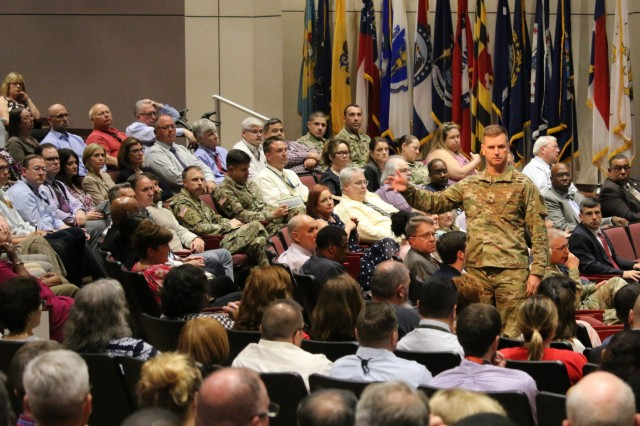 Brig. Gen Todd Royar, Aviation and Missile Command commander, addresses more than 500 attendees during his first town hall with the AMCOM workforce. Royar assumed command of AMCOM June 10.