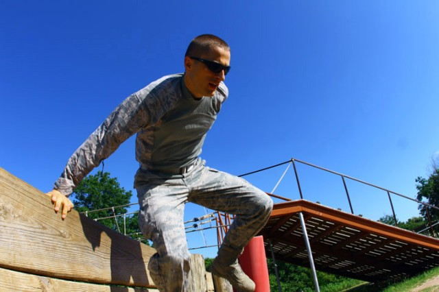 Air Force 1st Lt. Ioan Gaitan goes over the double-wall obstacle at the Fort Sill Combat Conditioning Course  June 25, 2019. Several officers from Altus Air Force Base and Soldiers here participated in a networking event to learn more about each others' missions.