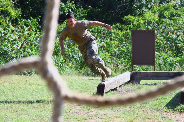 Army Capt. Michael Sanchez completes the balance beam event and heads toward the rope-climb obstacle June 25, 2019, at Fort Sill's Combat Conditioning Course. Sanchez is a student in the Air Defense Artillery Captains Career Course.