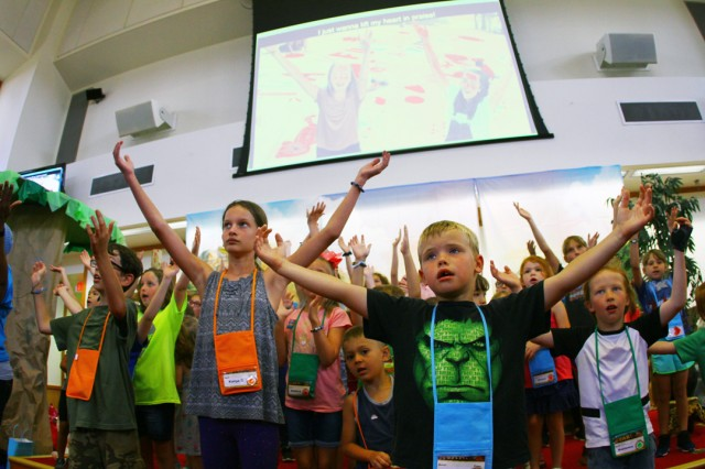 Children at the Fort Sill Vacation Bible School sing songs of praise during the final day of VBS June 28, 2019, at the Frontier Chapel Center. About 140 children spent the week meeting other kids and learning about Jesus and God in the nondenominational program.