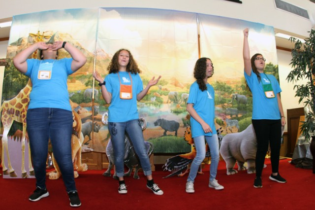 Animators lead a song and dance to get children into the spirit during Vacation Bible School June 28, 2019 at the Frontier Chapel Center.