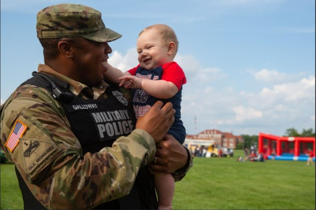 Sgt. 1st Class Mario Galloway, Fort Knox Military Police, says hello and happy Fourth of July to 7-month-old Nieko during the 4th of July Celebration on Brooks Field at Fort Knox July 4, 2019. The celebration was run by the Fort Knox Directorate of Family and Morale, Welfare and Recreation, and included family activities, live music, concessions and a fireworks display.