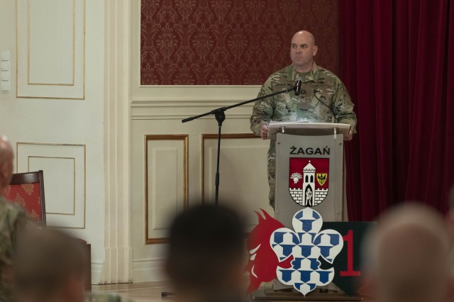 Col. Charles S. Armstrong, outgoing commander, 1st Armored Brigade Combat Team, 1st Infantry Division, addresses the audience during a change of command ceremony at Ducal Palace Zagan, Poland, July 7, 2019. The Devil Brigade is part of more than 6,000 U.S. regionally-allocated Soldiers in Germany, Bulgaria, Estonia, Hungary, Latvia, Lithuania, Poland and Romania, on a nine-month rotation, in support of Atlantic Resolve. Atlantic Resolve provides ready, combat-credible forces through multinational training and security cooperation activities. (U.S. Army photo by Sgt. Thomas Mort)