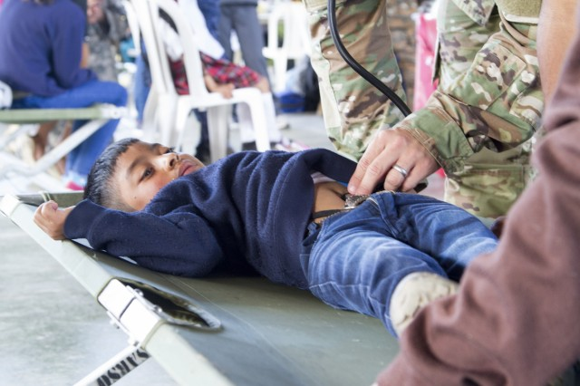 U.S. Army National Guard Capt. James Tucker of the Lubbock, Texas-based 413th Civil Affairs Battalion, treats a boy during a medical readiness training exercise during exercise Beyond the Horizon. Beyond the Horizon is a joint annual training exercise that combines medical, dental, veterinary and engineering missions to improve the operational readiness of U.S. Forces and reinforce regional stability and interoperability with allied forces, resulting in tangible benefits to the people of Guatemala.