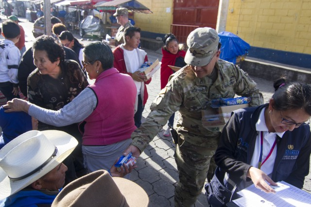 U.S. Army Reserve Sgt. Richard McDonald of the Lubbock, Texas-based 413th Civil Affairs Battalion, hands out juice and cookies to those waiting in line to receive free medical and dental care as part of a medical readiness training exercise during exercise Beyond the Horizon. Beyond the Horizon is a joint annual training exercise that combines medical, dental, veterinary and engineering missions to improve the operational readiness of U.S. Forces and reinforce regional stability and interoperability with allied forces, resulting in tangible benefits to the people of Guatemala.