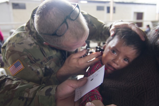 U.S. Army National Guard Maj. Steve Williams of the the Missouri Medical Detachment based in Jefferson City, Mo., checks a young boy's ear during a medical readiness training exercise during exercise Beyond the Horizon. Beyond the Horizon is a joint annual training exercise that combines medical, dental, veterinary and engineering missions to improve the operational readiness of U.S. Forces and reinforce regional stability and interoperability with allied forces, resulting in tangible benefits to the people of Guatemala.