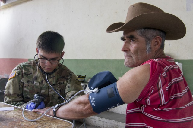 U.S. Army Reserve Spc. Markchristian Dizon, Mountain View, Calif.-based 352nd Combat Support Hospital, checks a man's blood pressure as part of a medical readiness training exercise during exercise Beyond the Horizon. Beyond the Horizon is a joint annual training exercise that combines medical, dental, veterinary and engineering missions to improve the operational readiness of U.S. Forces and reinforce regional stability and interoperability with allied forces, resulting in tangible benefits to the people of Guatemala.