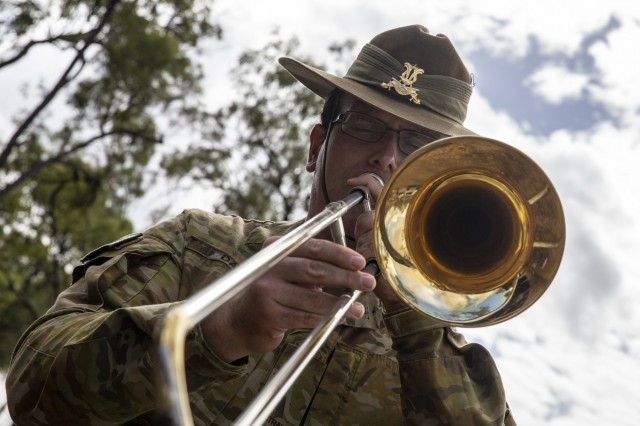 A member of The Band of The 1st Battalion, The Royal Australian Regiment plays the trombone at St. Christopher's Chapel, Nerimbera, Queensland, Australia, July 7, 2019. St. Christopher's Chapel was built by American troops during World War II, it stands today as a monument to the century long partnership between the U.S. and Australia.