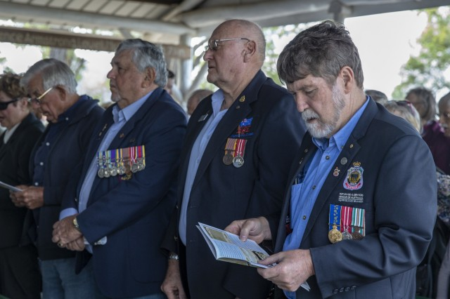Australian veterans sing during a church service at St. Christopher's Chapel, Nerimbera, Queensland, Australia, July 7, 2019. St. Christopher's Chapel was built by American troops during World War II, it stands today as a monument to the century long partnership between the U.S. and Australia.