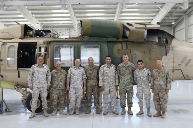 U. S. Army Soldiers and Royal Jordanian Air Force members gather for a photo while conducting an aviation subject matter exchange in Amman, Jordan, June 19, 2019. (U.S. Army National Guard photo by Staff Sgt. Veronica McNabb)