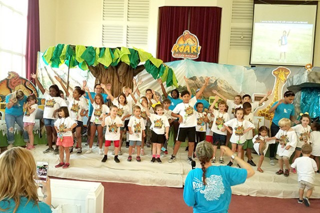 """Children perform a show June 29 as a finale to the Vacation Bible School, held at the Hunter Chapel on Hunter Army Airfield.  This year's theme was """"Roar! Life is wild - God is good!"""" (Photo by Steve Hart)"""