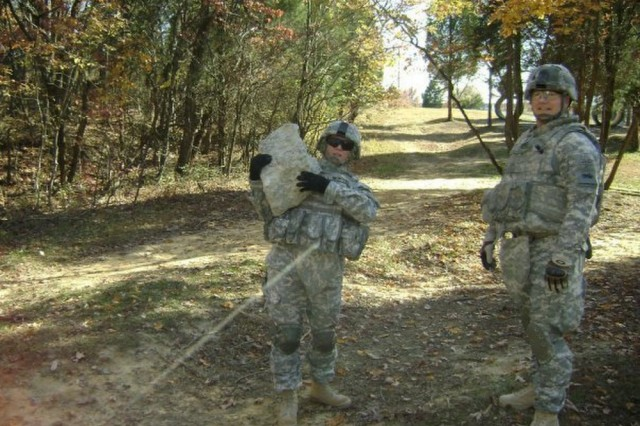 "Kay Coyne, a Department of the Army civilian, and brother Command Sgt. Maj. John Wayne Troxell, participate in a bayonet course at Fort Knox, Kentucky, Nov. 11, 2008. The course took place after Coyne returned from Kuwait and allowed the siblings a chance to spend some quality ""Army"" time together. (Courtesy photo)"