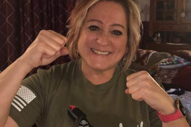 "Kay Coyne, a Department of the Army civilian and sister to Command Sgt. Maj. John Wayne Troxell, Senior Enlisted Adviser to the Chairman of the Joint Chiefs of Staff wears a shirt supporting her brother April 15, 2008. Coyne attributes the statement on the shirt ""surrender or die"" as ""the entrenching tool statement that has become his [Troxell's] legacy"". (Courtesy photo)"