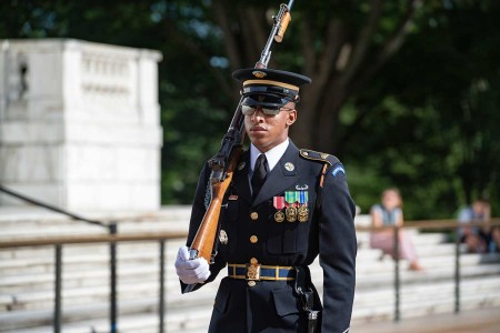 A sentinel from the 3rd U.S. Infantry Regiment (The Old Guard) walks the mat at the Tomb of the Unknown Soldier, Arlington National Cemetery, Arlington, Virginia, July 1, 2019.
