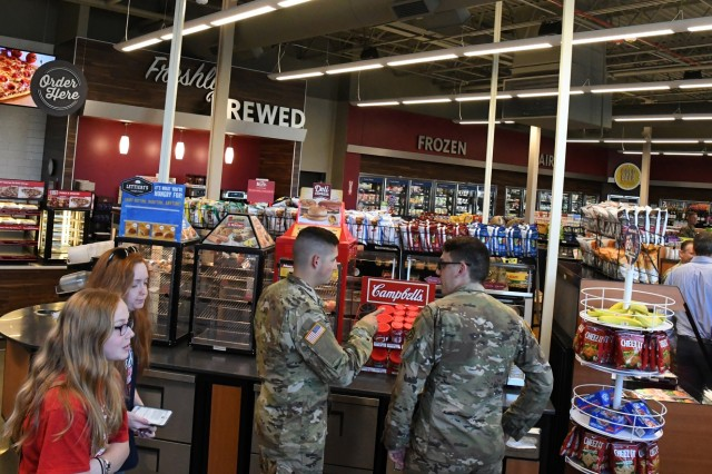 Fort Drum Soldiers and family members have a convenient new Express where they can fill up on gas, stock up on healthy snacks like fresh fruit and protein bars, get a haircut at the new barbershop or grab a meal. A ribbon-cutting ceremony was conducted July 8 for the grand opening of the Ontario Express, Bldg. 1485, at the intersection of Ontario Avenue and Tigris River Valley Road. (Photo by Mike Strasser, Fort Drum Garrison Public Affairs)