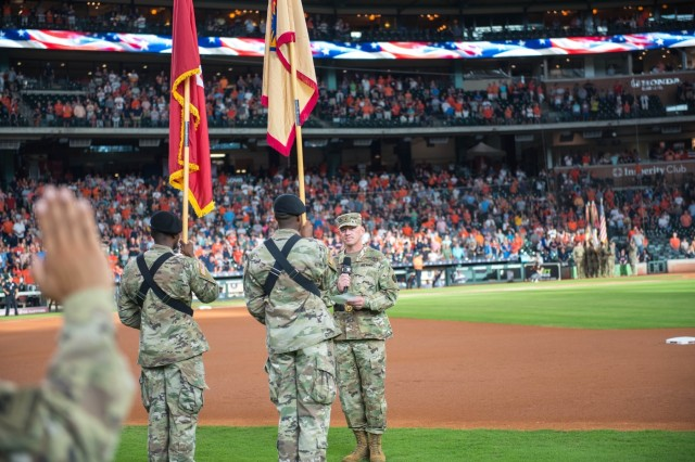 Brig. Gen. Darren L. Werner, Commanding General, 13th ESC, administers the Oath of Enlistment to 13th ESC Soldiers and other III Corps and Fort Hood Soldiers during a mass reenlistment ceremony July 5 at Minute Maid Park in Houston, Texas.  The ceremony was the sixth recommitment ceremony the 13th ESC has put together working with community partners across Texas, but the second consecutive July event hosted by the Houston Astros. (U.S. Army photo by Sgt. 1st Class Kelvin Ringold)