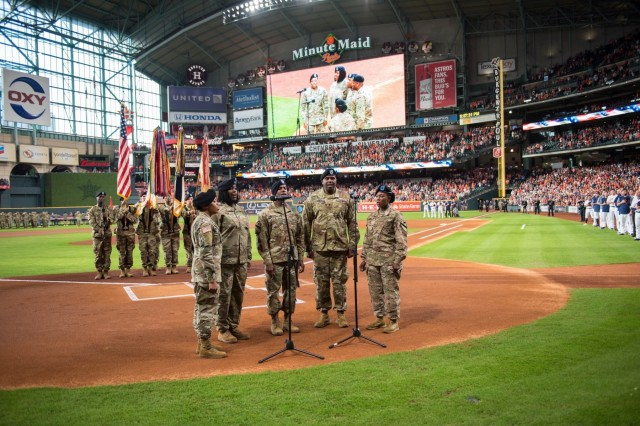 The 13th ESC Singing Warriors sing the National Anthem during a mass reenlistment ceremony July 5 at Minute Maid Park in Houston, Texas.  The ceremony was the sixth recommitment ceremony the 13th ESC has put together working with community partners across Texas, but the second consecutive July event hosted by the Houston Astros. (U.S. Army photo by Sgt. 1st Class Kelvin Ringold)