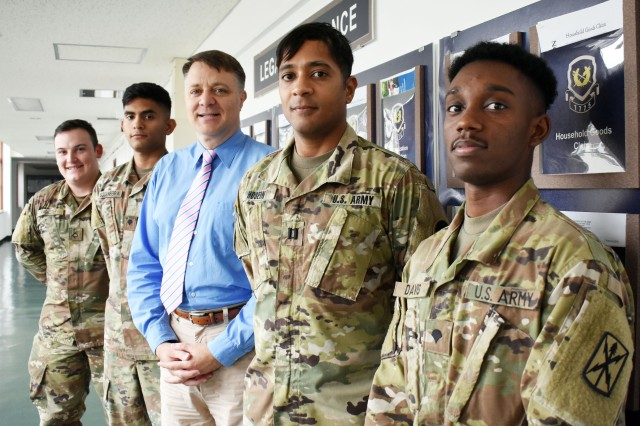 From left, Pfc. Joshua Knightstep, paralegal; Spc. Michlo Bocanegra, paralegal; Kent Herring, attorney and legal assistance director; Capt. Anthony Hosein, legal assistance attorney; and Spc. Damani Davis, paralegal, pose for a photo outside the U.S. Army Japan Legal Assistance Office at Camp Zama July 8. The office won the Army Chief of Staff Award for Excellence in Legal Assistance for fiscal 2018.