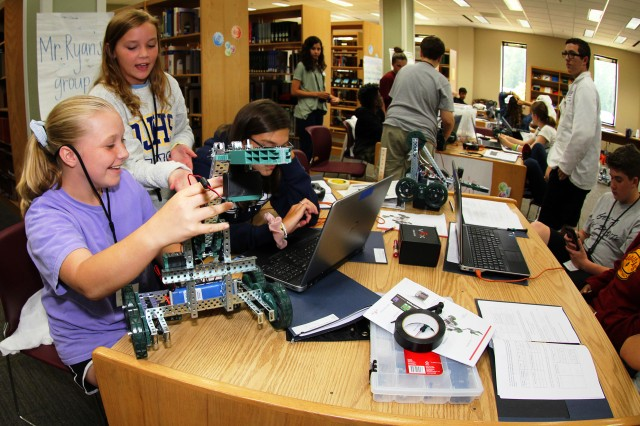 GEMS participants work to program their robot in the robotics portion of the program for eighth and ninth graders June 25 at the U.S. Army Aeromedical Research Laboratory.