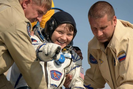 Expedition 59 NASA astronaut Anne McClain is helped out of the Soyuz MS-11 spacecraft just minutes after she, Canadian Space Agency astronaut David Saint-Jacques, and Roscosmos cosmonaut Oleg Kononenko, landed in a remote area near the town of Zhezka...