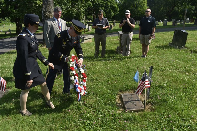 New York Army National Guard 1st Lts. Tiffany Campbell, left, and Thomas Helveston, lay a wreath at the grave site of Lt. Col. William O'Brien, at St. Peter's Cemetery, Troy, N.Y., on July 7, 2019. Medal of Honor recipient William O'Brien was remembered for his service with the 27th Division during the Battle of Saipan, 75 years after the attack.