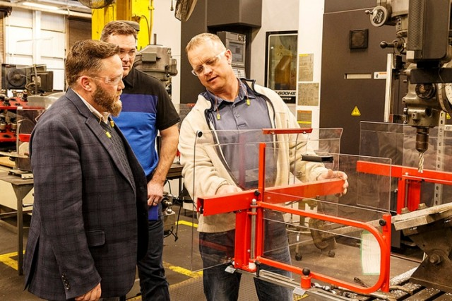 Erik Gustafson (left), TACOM Safety and Occupational Health program manager, reviews newly installed machine guards at Anniston Army Depot.