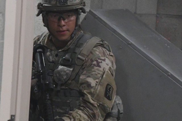 A Soldier from Bravo Company, 1-184 Infantry Battalion, trains on clearing a building June 21 at the Camp Roberts Combined Arms Collective Training Facility (CACTF).