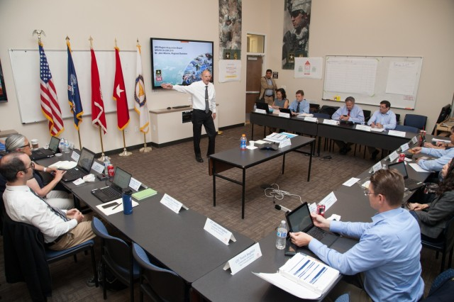 Mark Bennett, U.S. Army Corps of Engineers South Pacific Division quality program manager, leads a discussion about the division's current and future civil works and military construction projects during a regional meeting in Salt Lake City, Utah, June 24, 2019. Bennett and senior military and civilian leaders from the division met for a fourth-quarter fiscal year 2019 in-progress review of the innovative work USACE is accomplishing to help America prepare for the future. During the 4-day event, attendees also received leadership training, visited recent high-profile military construction projects at Hill Air Force Base, and attended a Salt Lake Bees baseball game where division commander, Brig. Gen. Kim Colloton, threw the game's first pitch. The AAA minor league team recognized Colloton's military service and the achievements of the division.  (U.S. Army photo by Ken Wright)