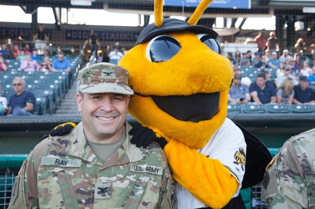 Col. David Ray, U.S. Army Corps of Engineers Sacramento District commander, is greeted by the Salt Lake Bees mascot during a game in Salt Lake City, Utah, June 24, 2019. Prior to the game, the AAA minor league team recognized USACE's innovative work that supports American infrastructure and national defense. Ray and other senior military and civilian leaders from the division met in Salt Lake City for a fourth-quarter fiscal year 2019 in-progress review of the innovative work USACE is accomplishing to help America prepare for the future. (U.S. Army photo by Ken Wright)