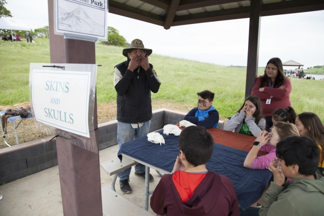 U.S. Army Corps of Engineers park rangers and Wilderness Inquiry volunteers teamed up at Black Butte Lake, California on April 11, 2019 to educate and train nearly 400 students from local elementary schools. Students from Orland's Fairview and Sierra View elementary schools learned how to safely navigate waterways in canoes and save others from drowning. The youngsters also learned important lessons about natural resources and the culture and history of the lake. (U.S. Army photo by Ken Wright)