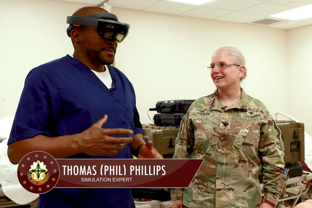 "Thomas ""Phil"" Phillips, a simulation expert with Madigan's Andersen Simulation Center, shows Col. Suzie Scott, the hospital's deputy commanding officer, augmented reality equipment in the latest episode of Madigan Works!"
