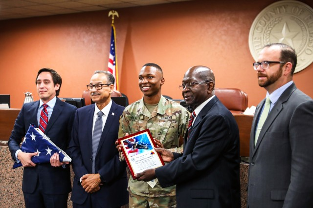 Sgt. Laderius Beattie, of Rosedale, Mississippi, a human resources specialist assigned to Headquarters and Headquarters Battalion, 1st Armored Division, receives with a plaque from Commissioner Carl L. Robinson, center right, representing El Paso County's Precinct 4, along with Commissioner Vincent Perez, left, of Precinct 3, Commissioner Carlos Leon, center left, of Precinct 1 and Commissioner David Stout, right, of Precinct 2, at the El Paso County Commissioners Court, July 8, in El Paso, Texas. The commissioners recognized Beattie, the 1AD Warrior of the Year for 2019, in an open meeting for his exemplary service as a Soldier in the United States Army and noted his embodiment of the Soldier's Creed.