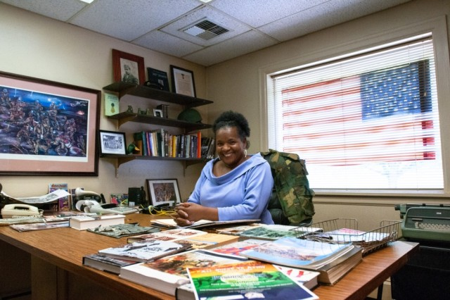 Jackie Jones-Hook, the daughter of a former American prisoner of war and executive director of the Tacoma Buffalo Soldiers Museum, poses in her Tacoma office, May 18. Jones-Hook is trying to protect a military site from commercial development that was critical to the selection of the American Lake area as the location of Camp Lewis.