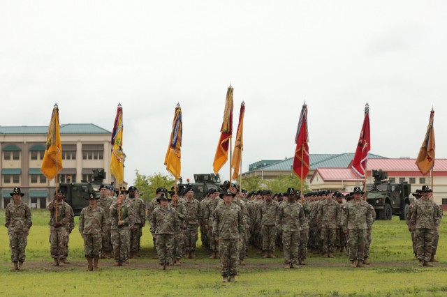 Soldiers of the 3rd Armored Brigade Combat Team, 1st Cavalry Division, stand in formation following the uncasing of their colors during a Transfer of Authority ceremony on Camp Humphreys, Republic of Korea June 11. The Greywolf Brigade assumed the nine month rotational unit mission from 3rd Armored Brigade, 1st Armor Division.