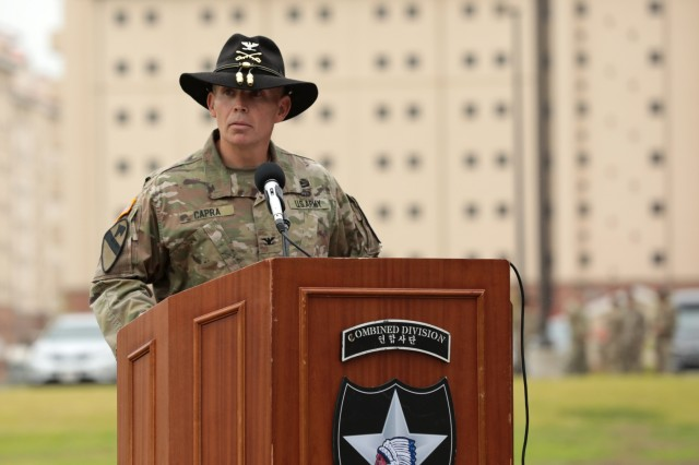 Col. Kevin Capra, commander of the  3rd Armored Brigade Combat Team, 1st Cavalry Division, speaks to attendees following the uncasing of the Brigade's colors during a Transfer of Authority ceremony on Camp Humphreys, Republic of Korea June 11. The Greywolf Brigade assumed the nine month rotational unit mission from 3rd Armored Brigade, 1st Armor Division.