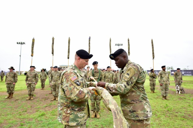 Col. Marc Cloutier, Commander of 3rd Armored Brigade Combat Team, 1st Armored Division, and Command Sgt. Maj. Michael Oliver, the 3rd ABCT, 1st Armored Div. CSM, case the unit colors as they end their nine-month rotation during the Transfer of Authority ceremony on Camp Humphreys, Republic of Korea June 11.U.S Army photos by Mr. Pak, Chin-U, 2nd Infantry Division/ROK-U.S. Combined Division Public Affairs Office