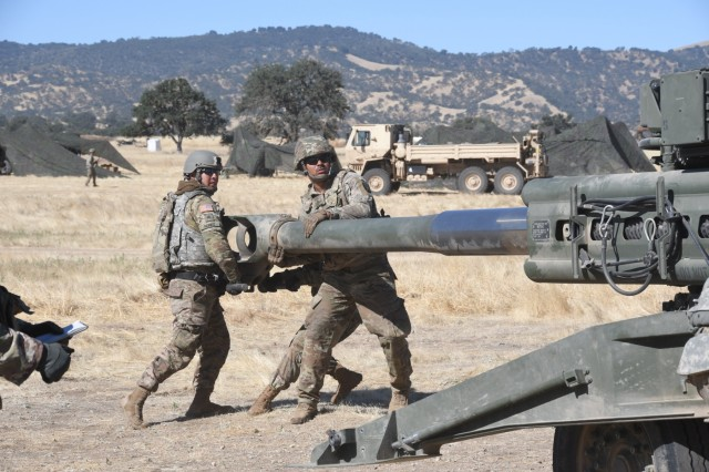"""Section 1-1, Charlie Battery, emplaces its M777A2 Howitzer in the field at Camp Roberts during an """"Artillery Rodeo"""" competition on June 26."""