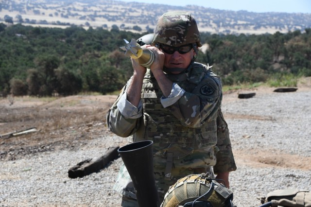 Command Sgt. Maj. Christopher Kepner, Senior Enlisted Advisor to the Chief, National Guard Bureau, hangs an 81mm mortar on June 24 in the field at Camp Roberts. Kepner came to Camp Roberts to visit the troops during Annual Training 2019.