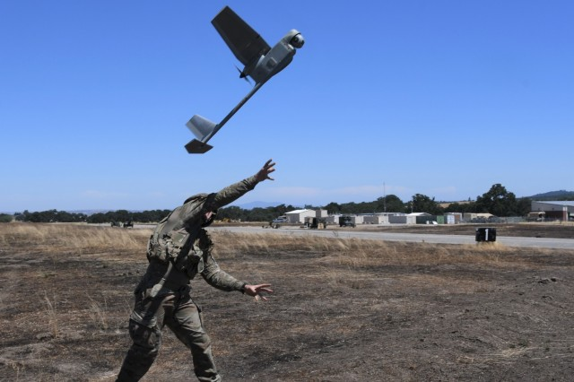 Mission Operator Spc. Matthew Rupprecht, Alpha Company, 1-160th Infantry Battalion, launches a Raven at McMillan Field on Camp Roberts on June 25.