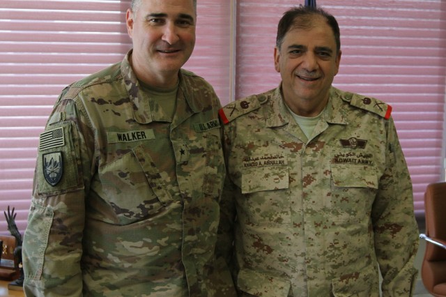 U.S. Army Brig. Gen. Clint E. Walker, deputy commanding general of the 1st Theater Sustainment Command, and Maj. Gen. Khaled A. Abdullah, commander of the Kuwait Naval Force and Kuwait Naval Base, smile for a photo during a key leadership engagement at the Kuwait Naval Base, Kuwait, July 3, 2019. They discussed upcoming U.S. Army leadership transitions, the status of U.S. Army watercraft, and potential partner nation sustainment training exercises. (U.S. Army National Guard photo by Sgt. Ashley Breland)