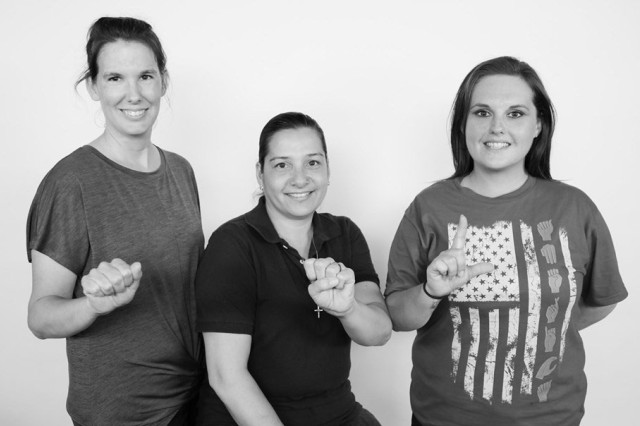 BACH employees, from left, Nicole Fitzwater, Wendyann Deasis-Duboise, and Kelly Money spell out A-S-L in  American Sign Language. The trio facilitate a free American Sign Language chat at the hospital twice a month for beneficiaries and staff interested in ASL. All skill levels are welcome. The group meets at noon on the first Monday and third Wednesday of each month at the hospital.