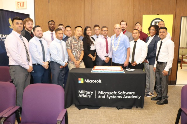 Just under 20 students comprise the inaugural class of Microsoft Software & Systems Academy, or MSSA, at Schofield Barracks. They join retired Marine Corps Maj. Gen. Chris Cortez, vice president of Microsoft Military Affairs, for a dedication photo.
