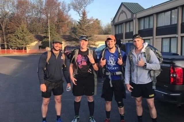 After beating a brain tumor, Spc. Shayn Lindquist, an Army Reserve civil affairs soldier, along with others, conducted a 150-mile ruck march across Michigan and his charity raised more than $3000 toward pediatric cancer charities.