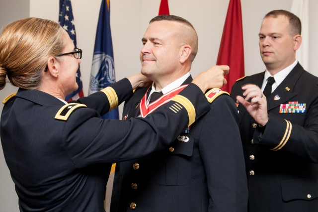 Col. David Ray, U.S. Army Corps of Engineers Sacramento District commander, is awarded the Silver Order of the de Fleury Medal from Brig. Gen. Kim Colloton, South Pacific Division commander, prior to Ray relinquishing command and retiring on July 11, 2019, in downtown Sacramento, Calif. The Army Engineer Association awarded the uncommon medal to Ray for the positive impact he made on the Army, USACE and the nation throughout his career. For the past three years, Ray commanded the nearly 1,100-person district, which stretches from southern California to western Colorado, and includes three of USACE's five largest U.S. projects. In addition to his final assignment, Ray's 28-year Army career included combat deployments and worldwide assignments as an engineer platoon leader, a battalion operations and executive officer, and battalion commander. (U.S. Army photo by Ken Wright)