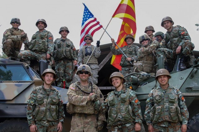 American Soldiers from the 56th Stryker Brigade Combat Team, Pennsylvania Army National Guard, and Soldiers from the Republic of North Macedonia, pose together by their tactical vehicles to show unity between the two nations, following the Exercise Decisive Strike's opening ceremony at the Training Support Centre Krivolak, North Macedonia, June 5, 2019. Decisive Strike highlights the inherent flexibility and strategic mobility of ground and air forces to rapidly respond to crises, allowing for the right presence where needed when needed.