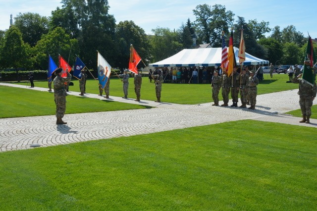 Capt. Carlie Wilson, commander, HHC USAG Stuttgart, issues commands to the joint-service German-American color guard during the USAG Stuttgart change of command ceremony, July 10, 2019.