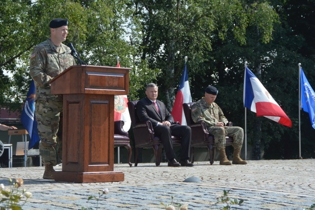 Col. Jason W. Condrey addresses the audience in German and English for the first time as commander of USAG Stuttgart, July 10, 2019.