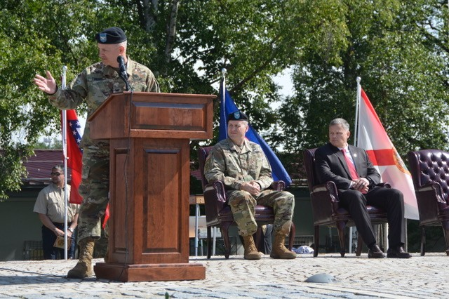 Col. Neal A. Corson, outgoing commander, USAG Stuttgart, welcomes the family of incoming commander Col. Jason W. Condrey during the change of command ceremony, July 10, 2019.